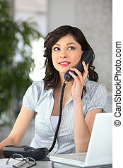 Receptionist answering the telephone
