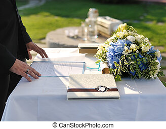 receptionist at a wedding ceremony and flower arrangement on...