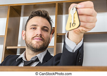 Receptionist Giving the Key