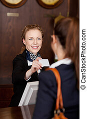 Receptionist handing out a business card
