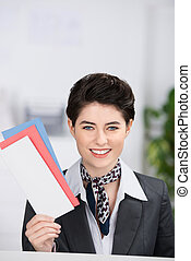 Receptionist Holding Traveling Documents - Happy young...