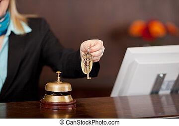 receptionist passing room keys