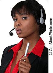 Receptionist shaking her pen