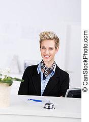 Receptionist Smiling At Desk