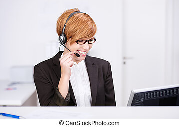 Receptionist Speaking On Headphones