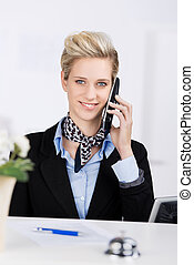 Receptionist Using Cordless Phone At Desk