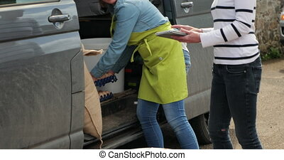 Recieving Food Deliveries - Two women sorting out their food...