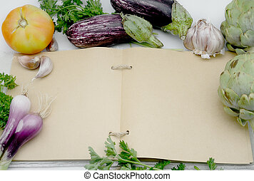 Recipe book open kitchen in a blank page surrounded by...