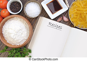 Open recipe book surrounded by cooking ingredients