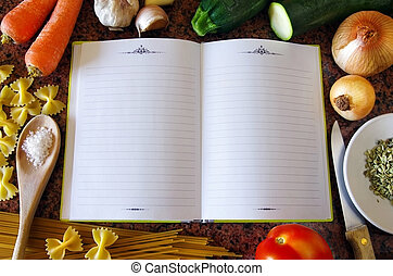 Recipe Book - Top view of an empty recipe book surrounded of...