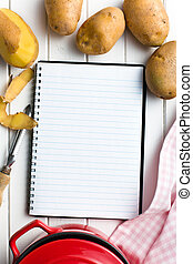 recipe book with potatoes
