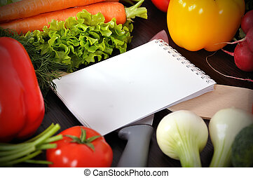 recipe book with vegetables