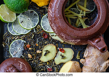 recipe for tea with lime and ginger - teapot with...