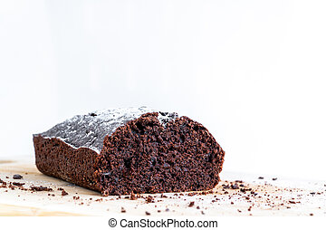 Recipe of homemade pastry. Isolated large piece of chocolate biscuit. Homemade chocolate sweet dessert. Bake at home.