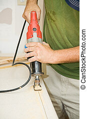 Reciprocating Saw on Laminate - Contractor cutting through ...