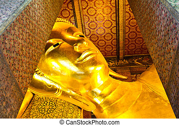 Reclining Buddha gold statue face. Wat Pho, Bangkok,...