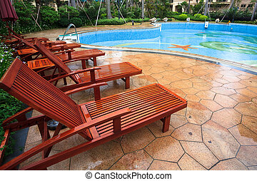 reclining chair of the swimming pool at the Luxury Hotel