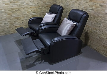 Black leather comfortable reclining massage chair.
