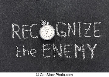 recognize the enemy phrase handwritten on chalkboard with...