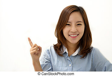 Recommend - Close-up of a young woman pointing