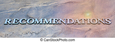 recommendations , writen wooden letters on stone background...