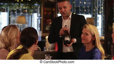 Recommending a Bottle of Champagne - Mature waiter...