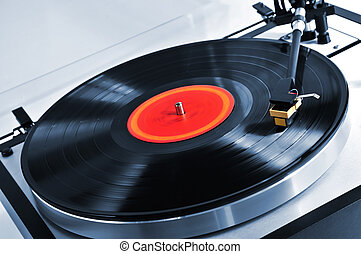 Record on turntable - Vinyl record spinning on turntable ...
