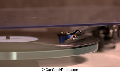 Record player, music plate. Playing vinyl record close up. Retro music device.