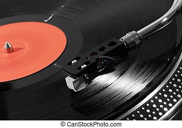 Record player playing vinyl