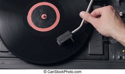 Record player playing vinyl. Retro Vinyl Turntable Stylus -...