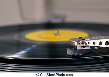 Close up side view of a record player.