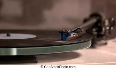 Record player stylus on disc. The needle on a vinyl record. Hi-fi audio equipment.