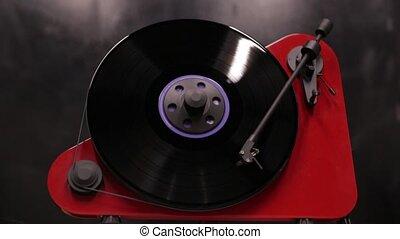 stylish modern vinyl record player playing a record. playing...