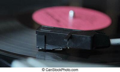 Record vinyl on turntable in vintage color tone