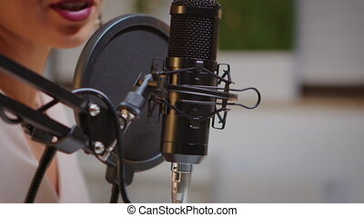 Recording audio at home using professional microphone. Creative online show presenter, On-air online production internet broadcast show host streaming live content, recording digital social media