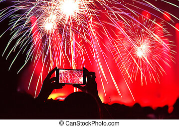 Recording fireworks with smart phone at New Year's Eve party
