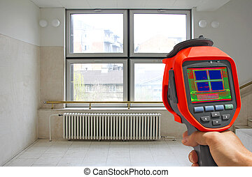 Recording Radiator and a window on a building with Thermal Camera