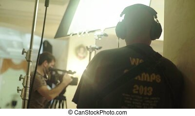 Recording sound on the set of a movie during filming. Filmmaking. Shooting. Stock video footage UHD (4K) / 3840-2160 / MP4 / Codec H.264 / 25 fps.