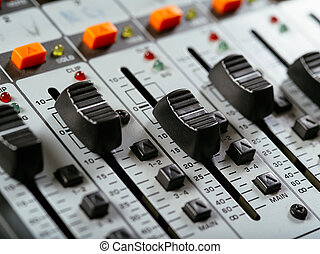 Macro photo of faders of a studio soundboard.