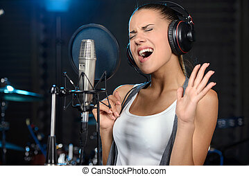 Recording Studio - Portrait of young woman recording a song ...