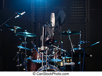 Recording Studio - Studio room with drum set, microphones...