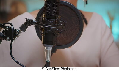 Presenter recording voice in home studio for media using professional microphone. Creative online show influencer, On-air online production internet broadcast show host streaming live content, recording