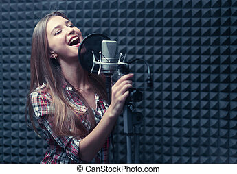 Recording - Young singer in a recording studio
