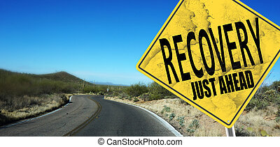 Recovery Just Ahead sign on desert road