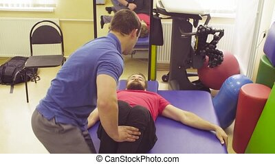 Recovery of a disabled man in a rehabilitation clinic -...