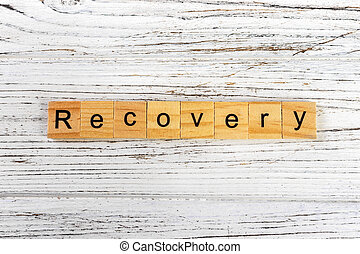 Recovery word made with wooden blocks concept