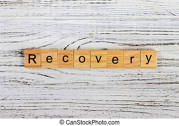 Recovery Word Written In Wooden Cube concept