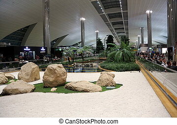 Recreation area in International airport in Dubai, UAE -...