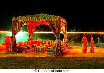 Recreation area of the luxury hotel in night illumination, Fujairah, UAE