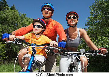 Recreation - Portrait of happy family on bicycles in the ...